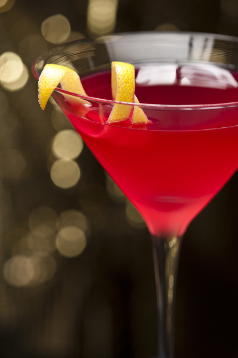 Cosmopolitan cocktail with lemon garnish